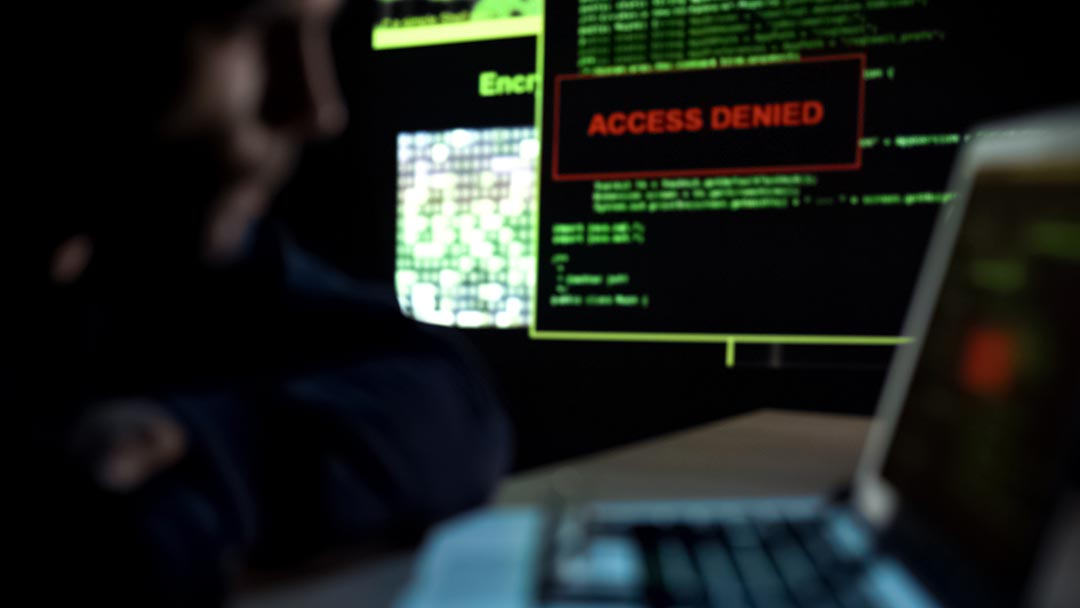 Hacker sees message access denied on monitor showing how small businesses can prevent hacking and ways to stop hackers